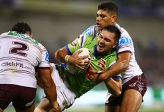 Jordan Rapana of the Raiders is tackled during the round eight NRL match between the Canberra Raiders and the Manly Sea Eagles at GIO Stadium on April 21, 2017 in Canberra, Australia.