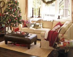 I love how cozy this sectional and ottoman look, and I love the deep window sill