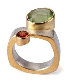 Tanja Ufer: prinite, hessonite garnet, finegold kumboo, silver,   22ct gold settings