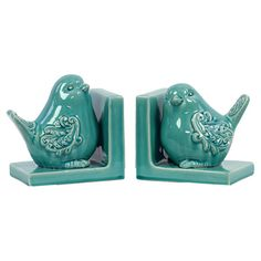 Ceramic bookends in turquoise with bird silhouettes.   Product: Set of 2 bookendsConstruction Material: Ceramic...