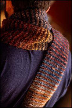 #Knit #Scarf   Pattern: Generic 1x1 Ribbed Striped Scarf (See details below)  Materials: Noro Silk Garden; 45 silk | 45 kid mohair | 10 lambswool  Amount: 4 balls in total in Shades 201 (2 balls), 234, and 86; Approx. 440yds/200g  Needles: US 7/4.5 mm KnitPicks Options  Dimensions: Approximately 5.5 inches in width and just over 6 feet in length, unblocked