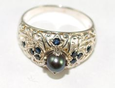 Gorgeous black pearl ring with filigree and sapphires.
