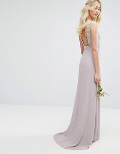 TFNC WEDDING High Neck Maxi Dress with Embellished Low Back Lightweight lined fabric High neck Cut-out detailing Embellished straps Open v-back Zip closure Regular fit - true to size Hand wash 100% Polyester
