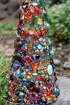 Tree of Seasons   A grandiose version of our jeweled baums ... These jeweled trees have become a favorite and each year I am asked when I will create another... well, here she is... and this one in particular is breathtaking! Hard for me to part with this beauty! A bit Bohemian for the caravan of colored jewels and a most whimsical way to celebrate Mother Earth. For autumn, the glow of orange, red, and olive mixed with vintage glass leaves and vintage Venetian glass blooms weave a fiery…