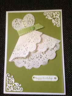 Hand made card using a paper doiley to create a dress on a card