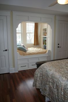Custom built-in bed in a bedroom alcove for reading!!  My life's dream...this takes a window seat to a whole new level!