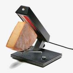 traditional raclette grill. Modern ones have a hot plate for grilling meat or vegetables while you wait for the cheese to melt....mmmm yummy!