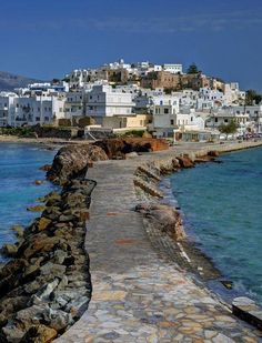 Naxos, Greece  Naxos: the biggest and the greenest island in Cyclades with impressively high mountains, fertile valleys, lush green gorges, stunning seascapes and traditional villages perched high on mountain tops, where the inhabitants still wear their traditional dress and live off the fruits of the land! Nàxos is also an island of beautiful old churches, monasteries and Venetian castles coexisting harmoniously with Cycladic cubic houses...