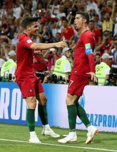 Cristiano Ronaldo of Portugal celebrates after scoring his team's third goal with team mate Andre Silva of Portugal during the 2018 FIFA World Cup Russia group B match between Portugal and Spain at Fisht Stadium on June 15, 2018 in Sochi, Russia.