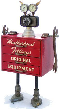 "Fobot - ""Weatherhead"" (created 2008 by artist, Amy Flynn).  Principal Components: Weatherhead fittings cabinet, camera, acetylene gauges, wrenches, chalk line reels"
