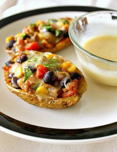 Southwest Loaded Baked Potato Skins; Can easily become vegetarian by substituting rice or quinoa for the meat.