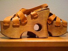 I put myself through college working as a made-to-measure shoe salesperson / crafter in San Francisco at a company called Leapin' Lizards Shoes. My brother made the bases out of wood; I measured feet so they could be made to order then  attached straps (wondering if I made these!). Had a pair like this I wore to my sister's wedding.
