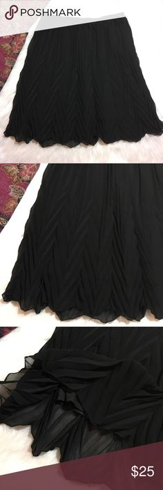 Beautiful flowy black skater skirt Super pretty and looks like an accordion skirt. Lined. Stretchy. Max Studio Specialty Products. Large. Max Studio Skirts Circle & Skater