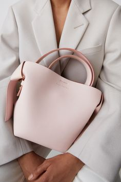Acne Studios Musubi Mini powder pink is a small bag with knot details based on the traditional Japanese obi sash. Cheap Purses, Cute Purses, Cheap Handbags, Prada Handbags, Luxury Handbags, Purses And Handbags, Leather Handbags, Popular Handbags, Cheap Bags