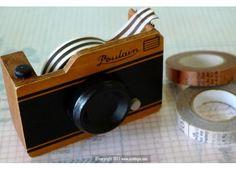 camera tape dispenser $16