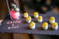 Passed hors d'oeuvres, like deviled eggs, were served on slate boards with item names written in chalk for an event at the Breakers Mediterranean Courtyard during the Palm Beach Food & Wine Festival in December 2013.  Photo: Lila Photo