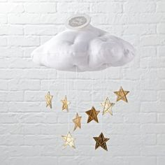 The night sky may not be visible from your little one's nursery, but this cloud mobile is the next best thing.  Featuring a handmade cloud and hanging metallic leather stars, it's the perfect accent for any nursery.