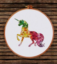 Geometric Unicorn cross stitch pattern - This would be really cool in perler beads mounted on a white canvas. Cross Stitch Horse, Unicorn Cross Stitch Pattern, Cross Stitch Art, Simple Cross Stitch, Cross Stitch Animals, Cross Stitching, Cross Stitch Embroidery, Cross Stitch Geometric, Modern Cross Stitch Patterns
