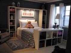 Bookshelves framing bed instead of headboard.
