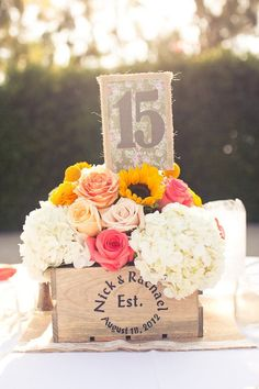 love... table numbers on burlap and then the bride and groom and wedding date on the wooden crate... so cute.