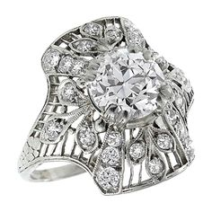 Art Deco 1.50 Carat Diamond Platinum Ring. Handcrafted from the Art Deco era, this ring centers a GIA certified old European cut diamond that weighs 1.50ct. and is graded J color with VVS2 clarity. The center stone is accentuated by old mine and French cut diamonds weighing approximately 1.00ct.