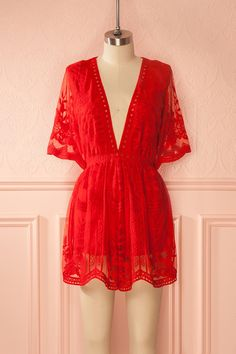 Louna Red #boutique1861 / Find the perfect blend of femininity and comfort in this romantic romper! The zipper up the back makes it easy to slip on, while the stretch lining makes it comfortable to wear day through till night. The transparent lace back and flared short sleeves give it a flirty, bohemian feel, while the scalloped hem and cut-outs at the waist will charm you. Pair it with high platform heels and a long pendant necklace for a fancy summer soirée!
