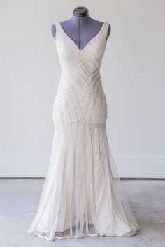 Sottero & Midgely wedding dress - rent for just $600 (original retail $2,000).  Deep-v neckline and trumpet silhouette wedding dress.   Save money on designer wedding dresses.  Rent wedding dresses online.