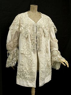 Lace coat c.1900 } Couture quality silk coat trimmed with handmade Cluny lace, c.1900.