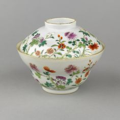 A Chinese porcelain bowl and cover painted in famille rose enamels and gilt. The cover with partly cupped rim. The bowl with rising sides, cupped, flared rim. Exterior of bowl and cover decorated with hibiscus, chrysanthemum and peony. More At FOSTERGINGER @  Pinterest