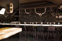 Black Marble - Onyx Wall - Sleek Seating - Paris Restaurant - Hospitality Design - Glam Style