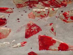 broken glass with blood; 1 cup sugar, 1/3 cup light corn syrup, 2 tablespoons water, red food dye