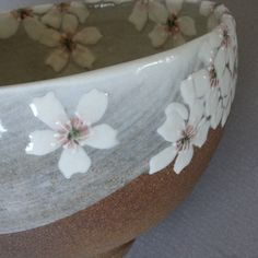 white cherry blossom bowl - could use stencils on the wet clay, paint colored slip over. remove stencils and fill in details...