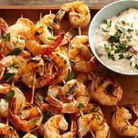 Grilled shrimp with red pepper dip are a tasty appetizer or main course.  - Traditional Home ®