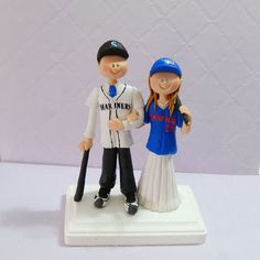 Sports cake topper....be better if mets and Yankees lol
