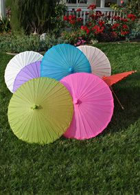 "Whether you are looking for something to keep the sun off or a stylish prop for photographs, these parasols are exactly the right thing. Bridesmaids can carry them down the aisle at an outdoor wedding for an added splash of color. They will bring a summery feel with them wherever they go! Measures: 32"" Diameter, 23 "" Length. View Parasol Colors View Alternate Image of Colors"