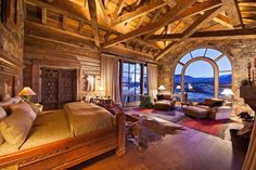 Amazing master bedroom.  Love the rustic look.