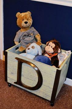 Deegan's nursery. Baby boy nursery decor. Toy crate on casters.