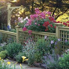 Ornamental Border / Small Yard Big Impact / Photos / Garden Planning / Landscaping / This Old House Lovin the fence to screen hoses, faucets, vents! Front Yard Fence, Dog Fence, Brick Fence, Concrete Fence, Pallet Fence, Wood Fences, Rustic Fence, Fence Stain, Fence Art