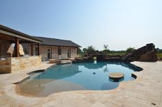 Outside Oasis built by Sapphire Custom Homes#SapphireCustomHomes#CustomHomeBuilder#Remodel#Outdoors#Pizza#Barbecue#Poolside#Pools##Waterslide#Acreage#Texas#RealEstate#RusticHome#Farmhouse