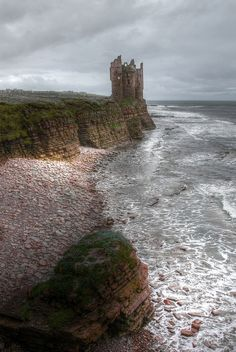 Keiss Castle is a partially ruined castle in Caithness, Scotland, located less than one mile north of Keiss village center, on sheer cliffs, overlooking the bay.