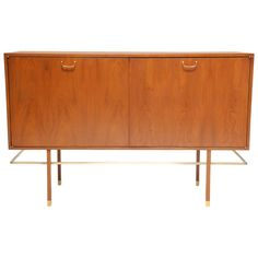 Mahogany Harvey Probber Sideboard with Brass Pulls and Walnut Doors | From a unique collection of antique and modern sideboards at https://www.1stdibs.com/furniture/storage-case-pieces/sideboards/