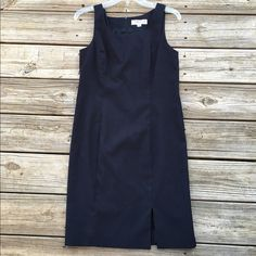 Black sleeveless dress with slit Gorgeous black dress that zips up in the back and has a slit in the front. In excellent condition! No flaws! Measures 36 inches from shoulder to hem. Polyester/rayon blend. Thanks for looking.💕 Taiga Dresses Midi