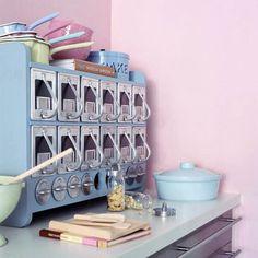 This looks like a seriously cool kitchen gadget. - I believe this is a soda shoppe's topping cabinet.