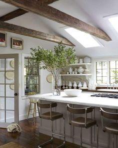 Wall decor, exposed beams, decorative shelves. Cozy.