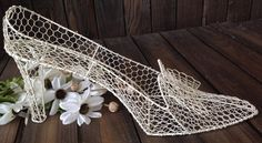A personal favorite from my Etsy shop https://www.etsy.com/listing/234403970/chicken-wire-shoe-large-white-shoe