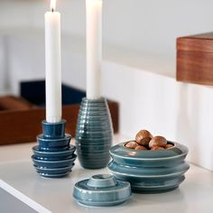 The popular and much-loved Cono candle holders and lidded jars are now available in blue and grey shades reminiscent the cold nordic win- ters and the clear night sky.