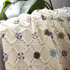 This traditional style blanket is easy to crochet. Worked in all over neutrals with slight pops of color creates a timeless blanket with a contemporary feel!