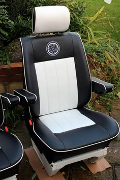 Here we have a set of VW T4 Caravelle Captain's seats fully re-trimmed in top quality automotive vinyl. They have a black vinyl base with white piping surround and VW embroidered badge on each chair back. The decorative pleat stitching to the perforated backs and bases as well as extra padding to the front and sides gives a plush finish. There are two freshly powder coated bases to both seats in a distinctive white finish as shown in the picture.