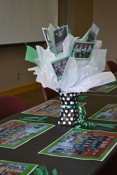 Table centerpieces with pictures of the girls throughout the year.