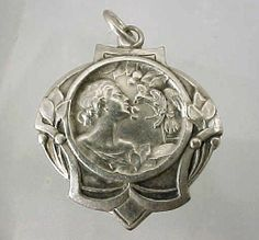 ANTIQUE ART NOUVEAU GERMAN SILVER YOUNG LADY FLIRTING WITH A BIRD CHARM PENDANT